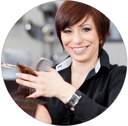 Woman smiling while cutting hair